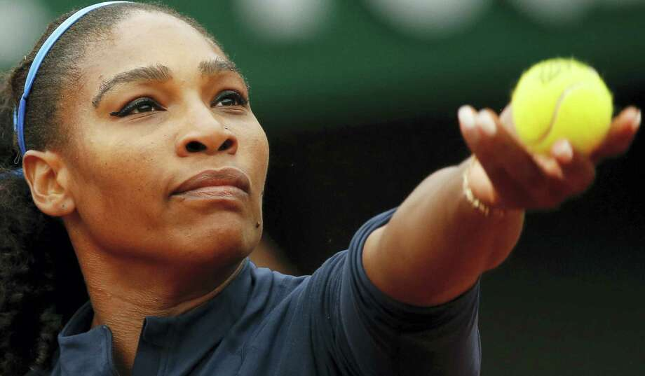 In this June 3, 2016 photo, Serena Williams of the U.S. serves the ball in the semifinal match of the French Open tennis tournament against Netherlands' Kiki Bertens at the Roland Garros stadium in Paris, France. Photo: AP Photo/Alastair Grant, File   / Copyright 2016 The Associated Press. All rights reserved. This material may not be published, broadcast, rewritten or redistribu