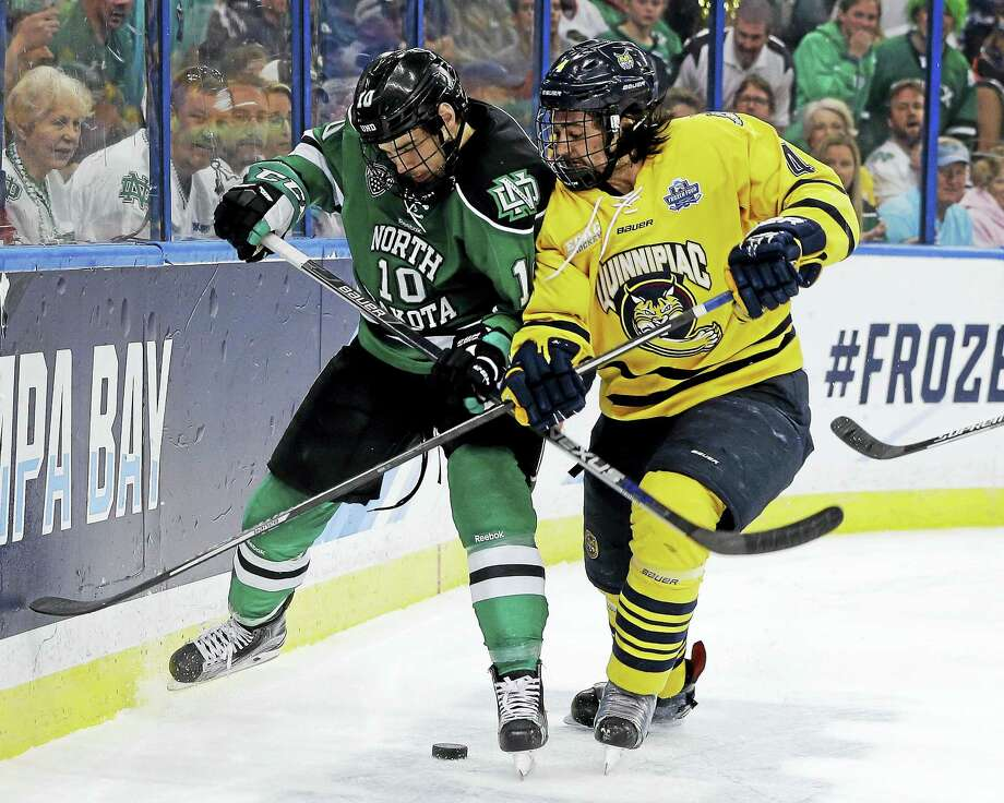 Quinnipiac defenseman Connor Clifton, right, battles for the puck during last season's national championship game against North Dakota. Photo: The Associated Press File Photo   / Copyright 2016 The Associated Press. All rights reserved. This material may not be published, broadcast, rewritten or redistribu