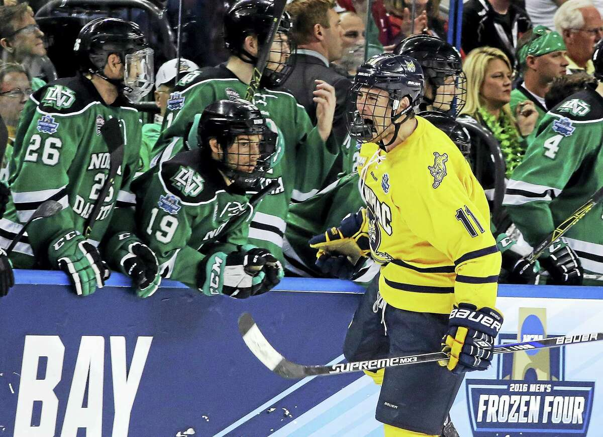 Quinnipiac forward Tim Clifton (11) reacts after scoring in last season's national championship game.
