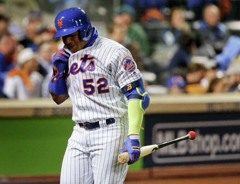 Yoenis Cespedes (52) walks back to the dugout after striking out against the Giants on Wednesday. Photo: Kathy Willens — The Associated Press   / Copyright 2016 The Associated Press. All rights reserved.