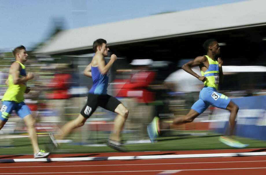 From right, Shaquille Walker, Chris Low and Casimir Loxsom run during qualifying for men's 800-meter race at the U.S. Olympic track and field trials on Friday in Eugene Ore. Photo: Marcio Jose Sanchez — The Associated Press   / AP