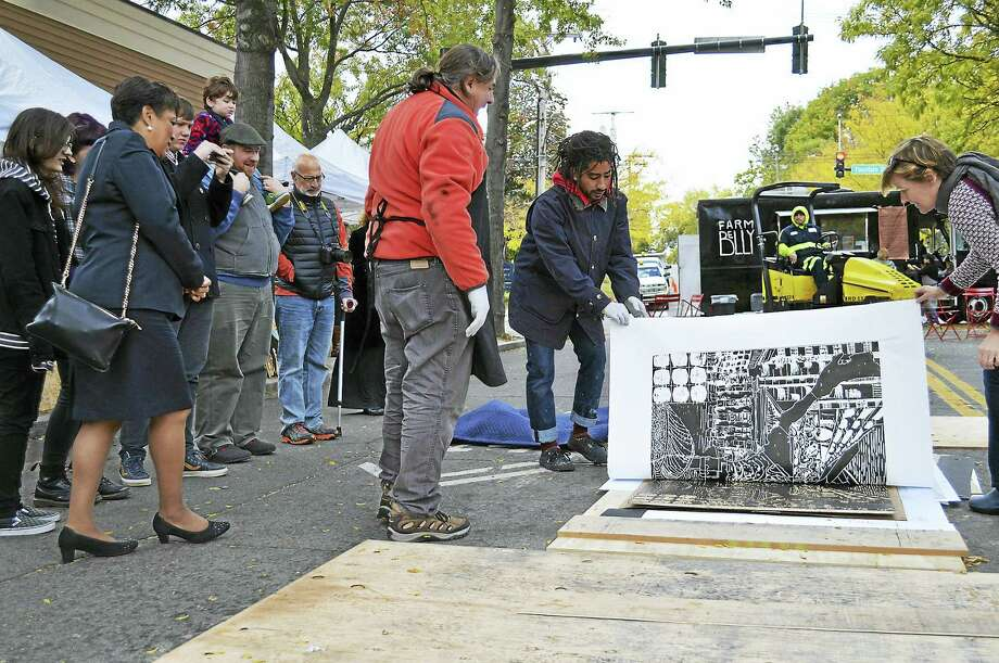 Mayor Toni Harp, left, watches an art demo in Westville last year. Photo: Photo Courtesy Of Graham Hebel