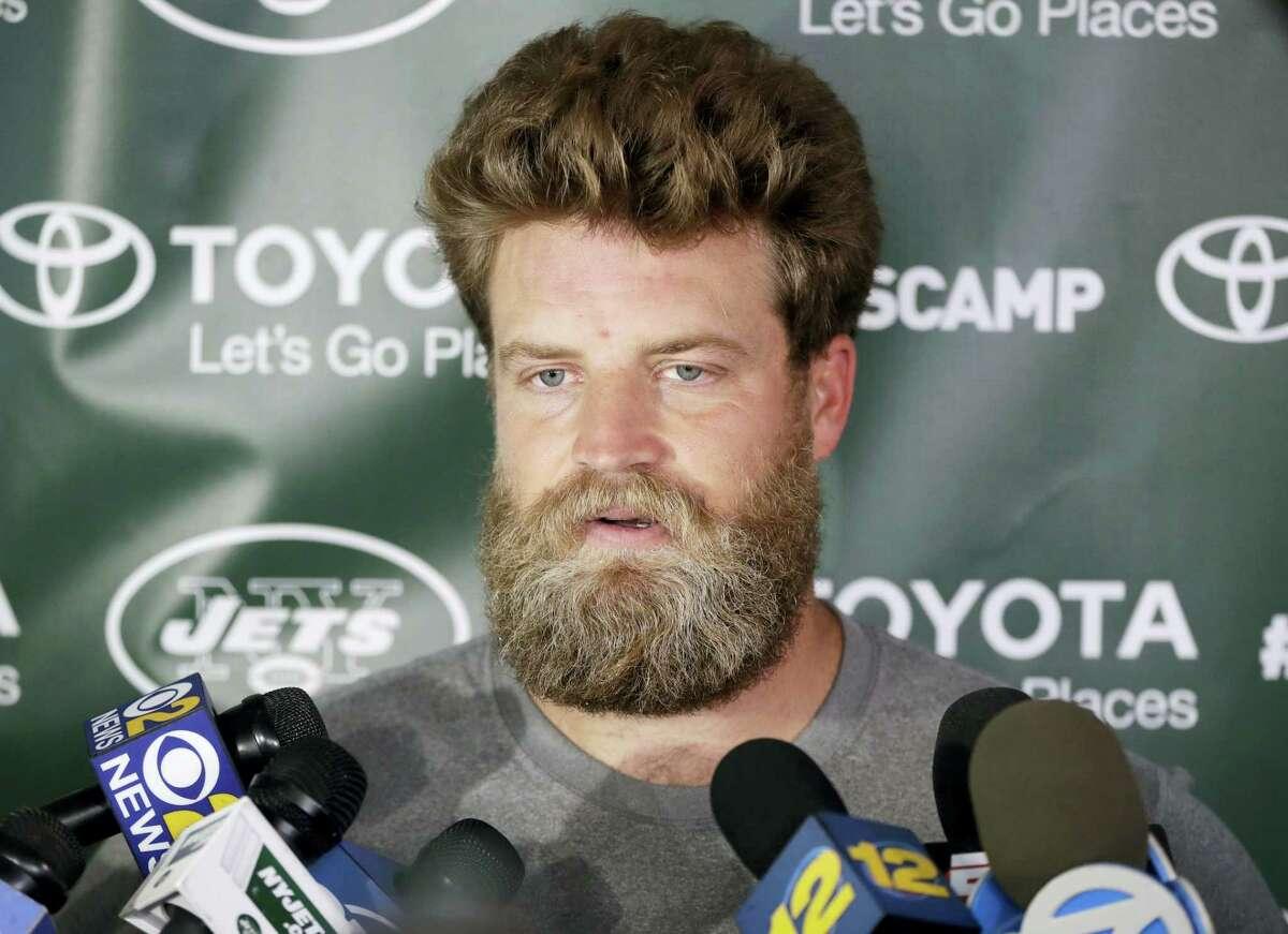 New York Jets quarterback Ryan Fitzpatrick talks to reporters last week.