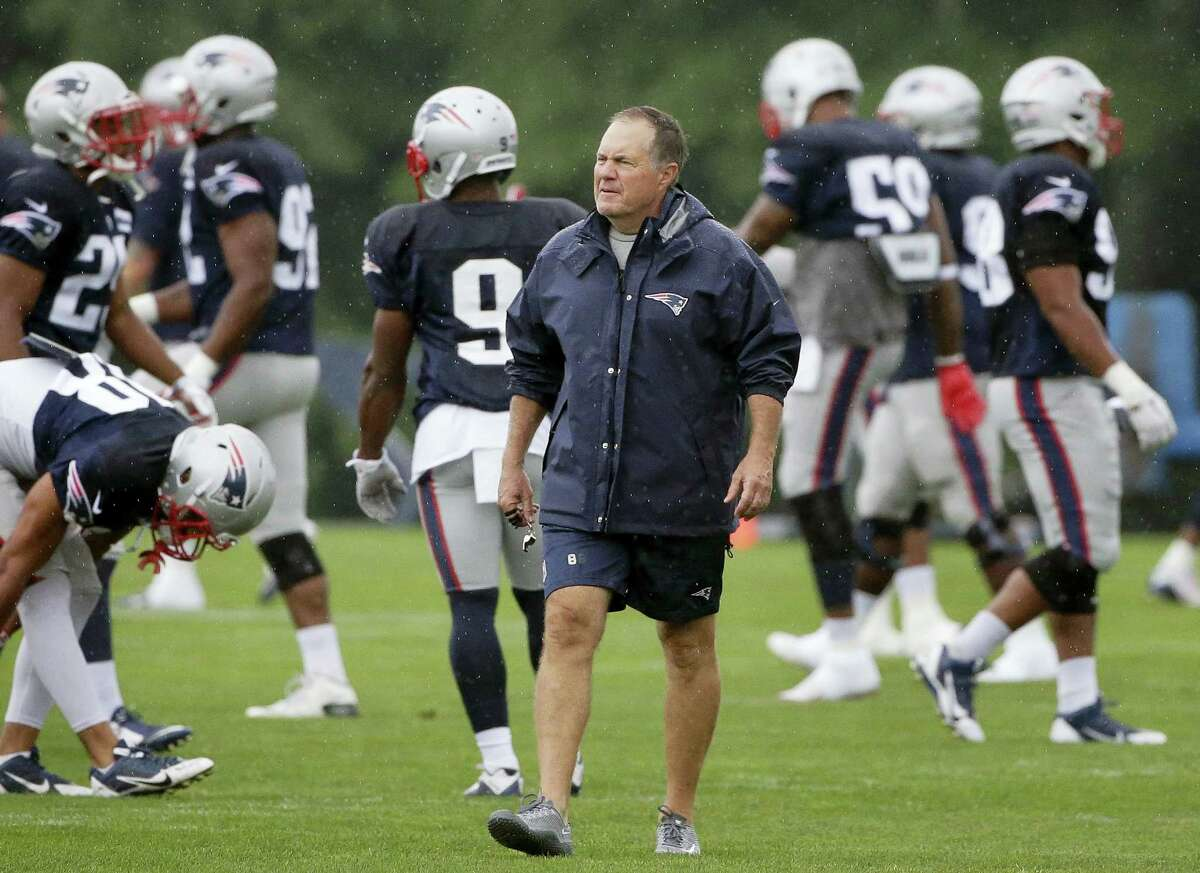 Bill Belichick walks on the field during a recent practice.