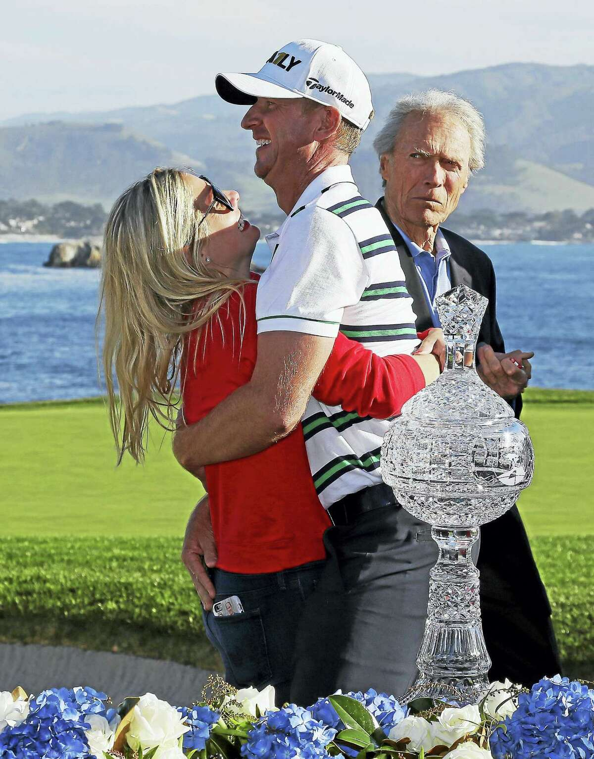 Vaughn Taylor is embraced by his wife, Leot, on the 18th green of the Pebble Beach Golf Links after winning the AT&T Pebble Beach National Pro-Am in February.