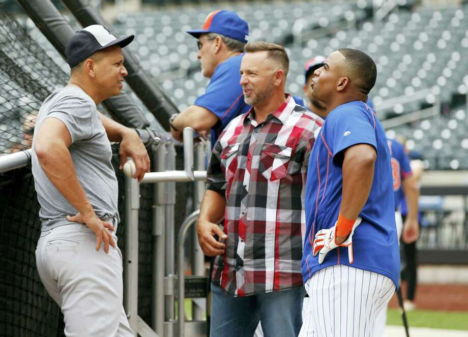 The Yankees' Alex Rodriguez, left, talks to MLB broadcaster Kevin Millar, center, in plaid shirt, and the Mets' Yoenis Cespedes on Tuesday. Photo: The Associated Press File Photo   / AP