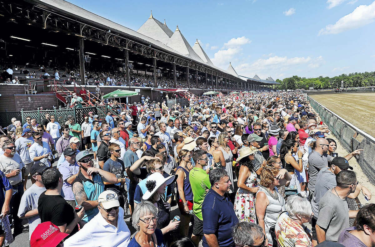 Fans watch the action during the fifth race on opening day of the season at Saratoga Race Course on July 22.