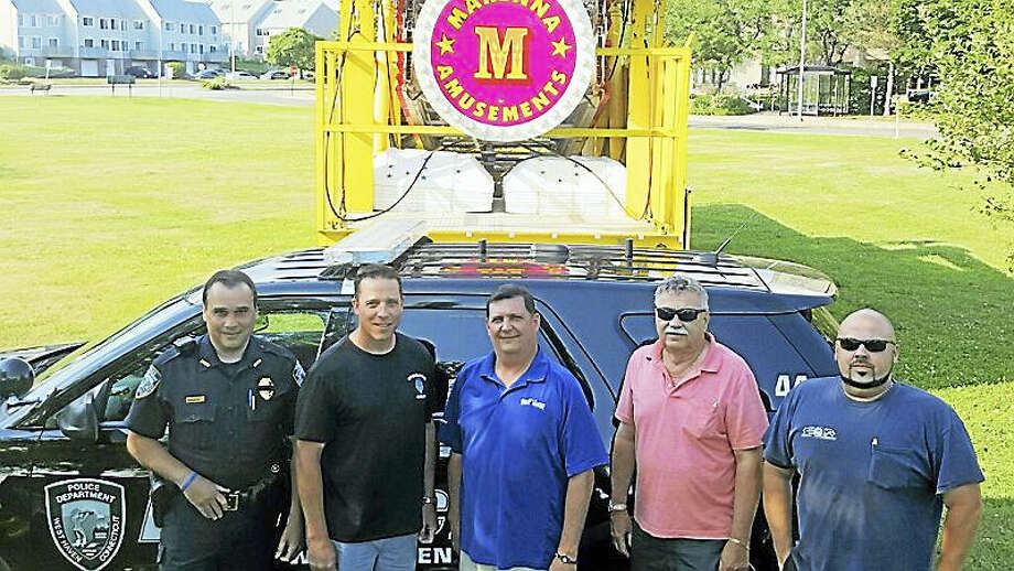 CONTRIBUTED PHOTO BY DAVID O'BRIEN  From left, Detective Robert Fazzino, vice president of the West Haven Police Department union; Detective Sean Faughnan, president of the union; Mayor Ed O'Brien, George Marenna Jr. and George Marenna III. Photo: Journal Register Co.