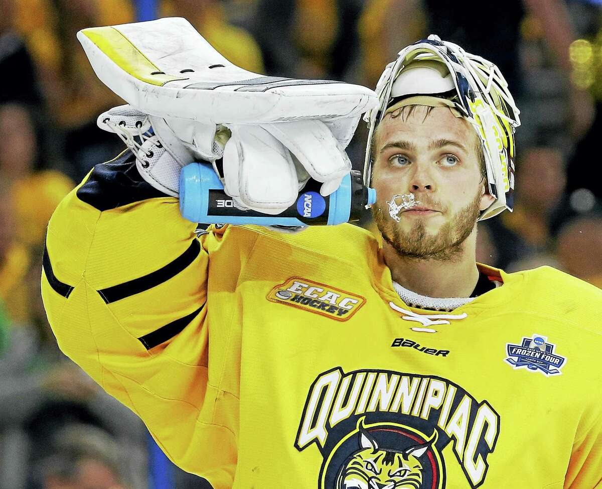Quinnipiac goalie Michael Garteig spits water after giving up a goal to North Dakota in NCAA Frozen Four championship game in Tampa, Fla., in April.