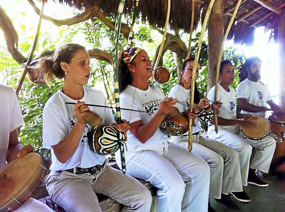 Women of Capoeira playing the traditional music that accompanies the martial art. Master Tisza Coelho from Brazil is in the center. She will be teaching at this weekend's woman led event celebrating women.