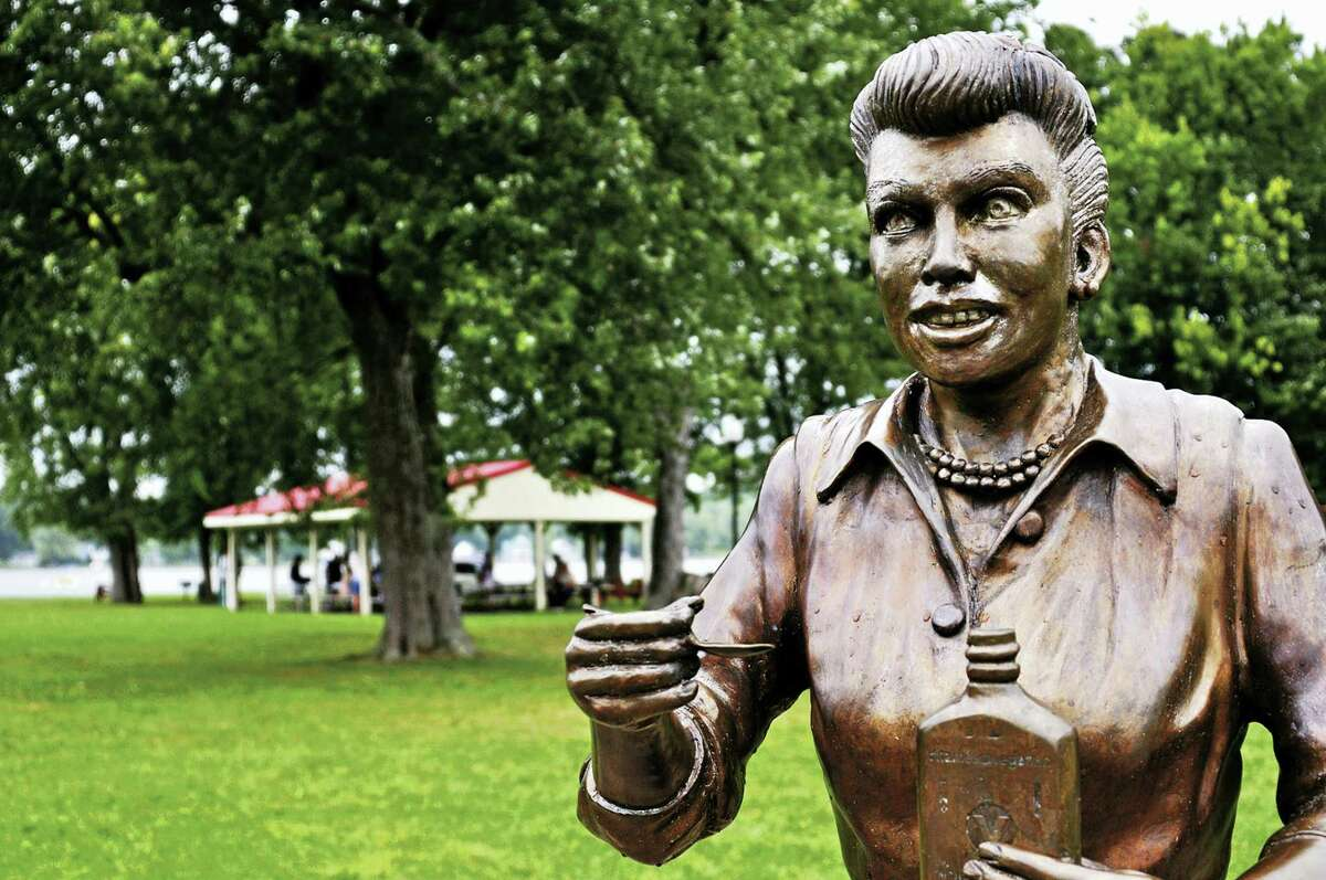 """In this Aug. 2012 photo, a hated bronze sculpture of Lucille Ball, dubbed """"Scary Lucy,"""" is displayed in Lucille Ball Memorial Park in the village of Celoron, N.Y. A new statue of Ball is being unveiled Saturday, Aug. 6, 2016, in the late actress' hometown to replace this one. Sculptor Carolyn Palmer hopes her tribute will please fans who demanded that another artist's unflattering version be banished."""