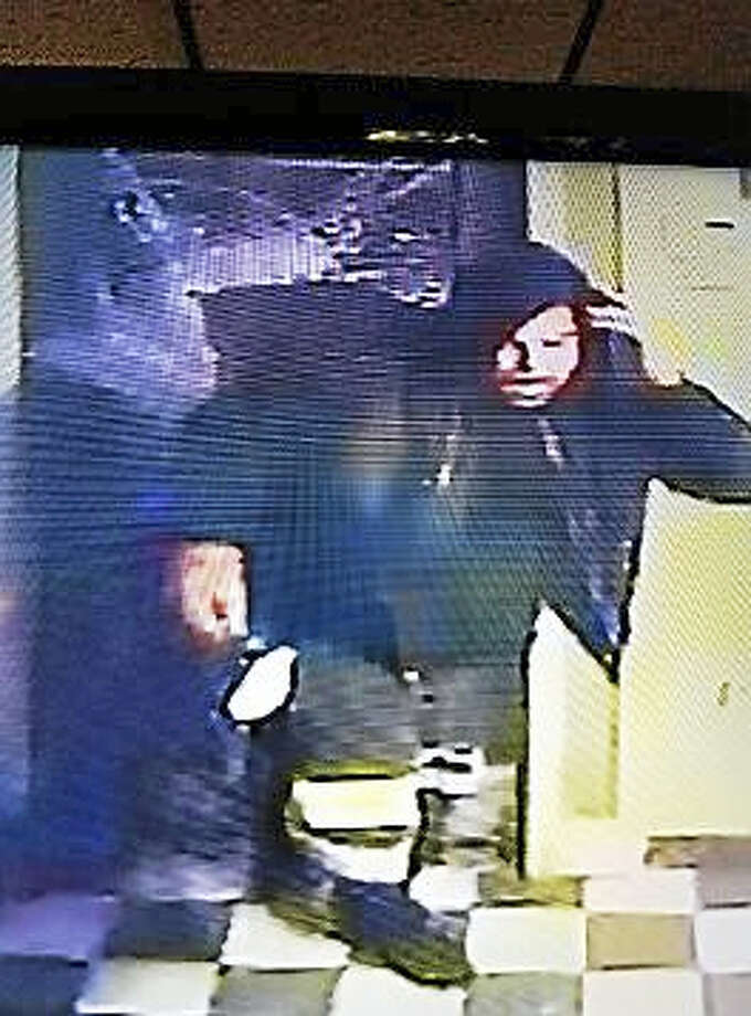 New Haven police are looking for help identifying the suspect in this surveillance photo, who is accused of committing several burglaries in the city. Photo: New Haven Police Department