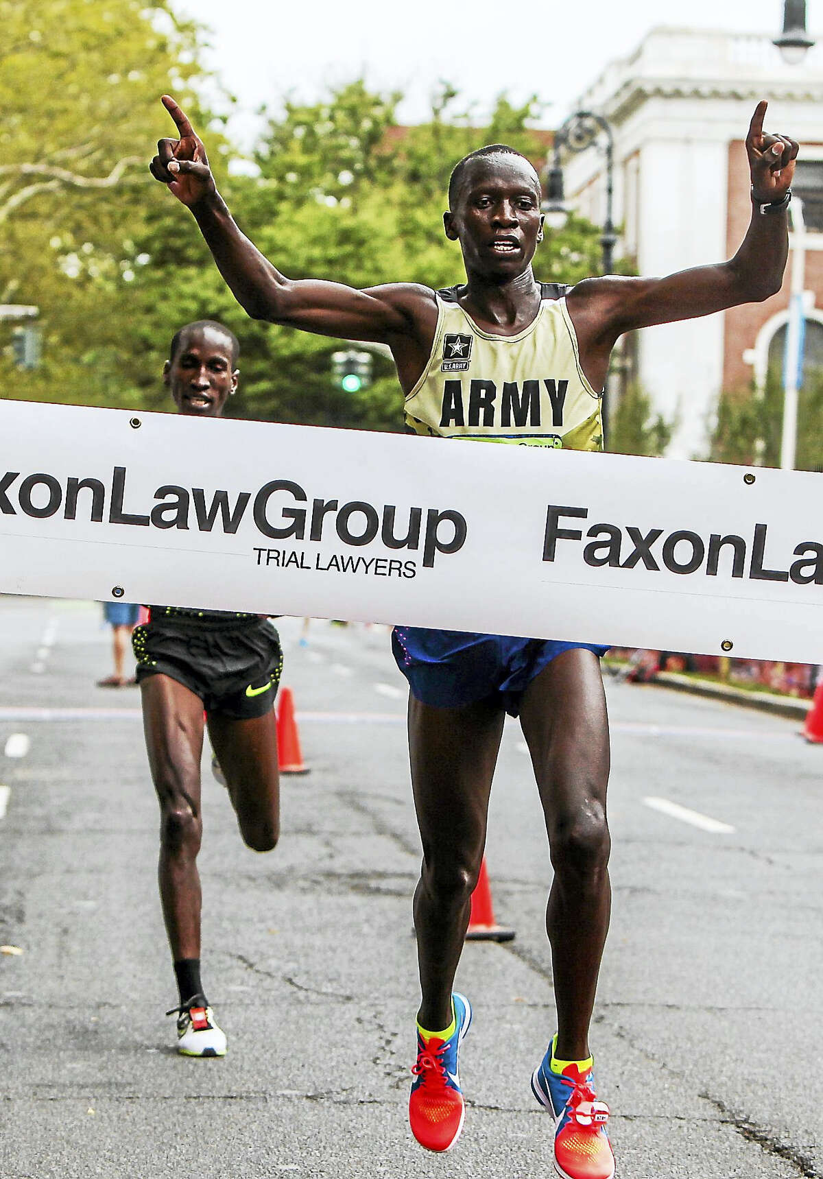 US Army Spc. Leonard Korir from Colorado Springs, Colorado wins the 39th Annual New Haven Road Race 20K Championship Monday morning.