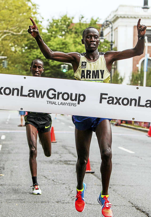 US Army Spc. Leonard Korir from Colorado Springs, Colorado wins the 39th Annual New Haven Road Race 20K Championship Monday morning. Photo: John Vanacore - For The New Haven Register   / John Vanacore/Register