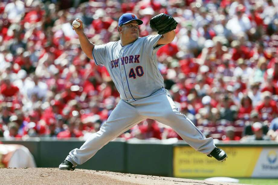 New York Mets starting pitcher Bartolo Colon throws during the first inning against the Cincinnati Reds Monday in Cincinnati. The Mets won 5-0. Photo: JOHN MINCHILLO - THE ASSOCIATED PRESS   / AP