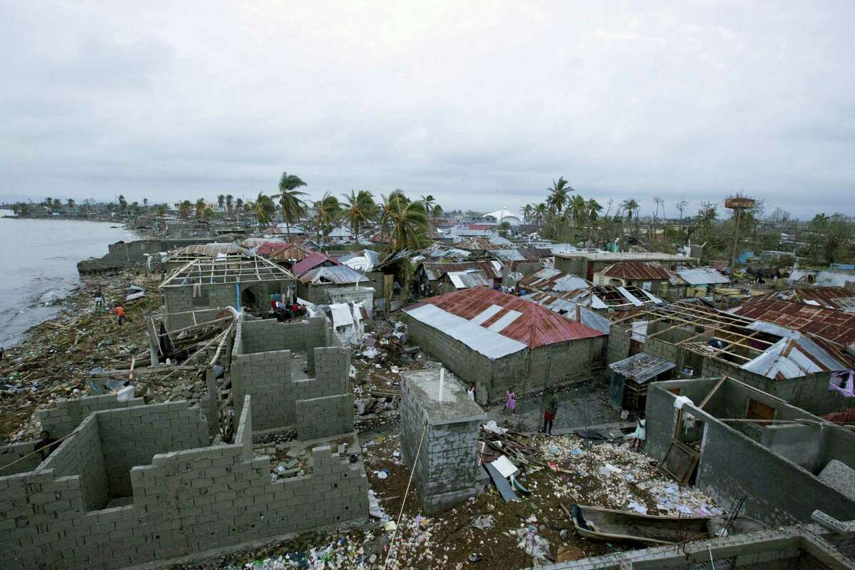 Homes lay in ruins after the passing of Hurricane Matthew in Les Cayes, Haiti, Thursday. Two days after the storm rampaged across the country's remote southwestern peninsula, authorities and aid workers still lack a clear picture of what they fear is the country's biggest disaster in years.