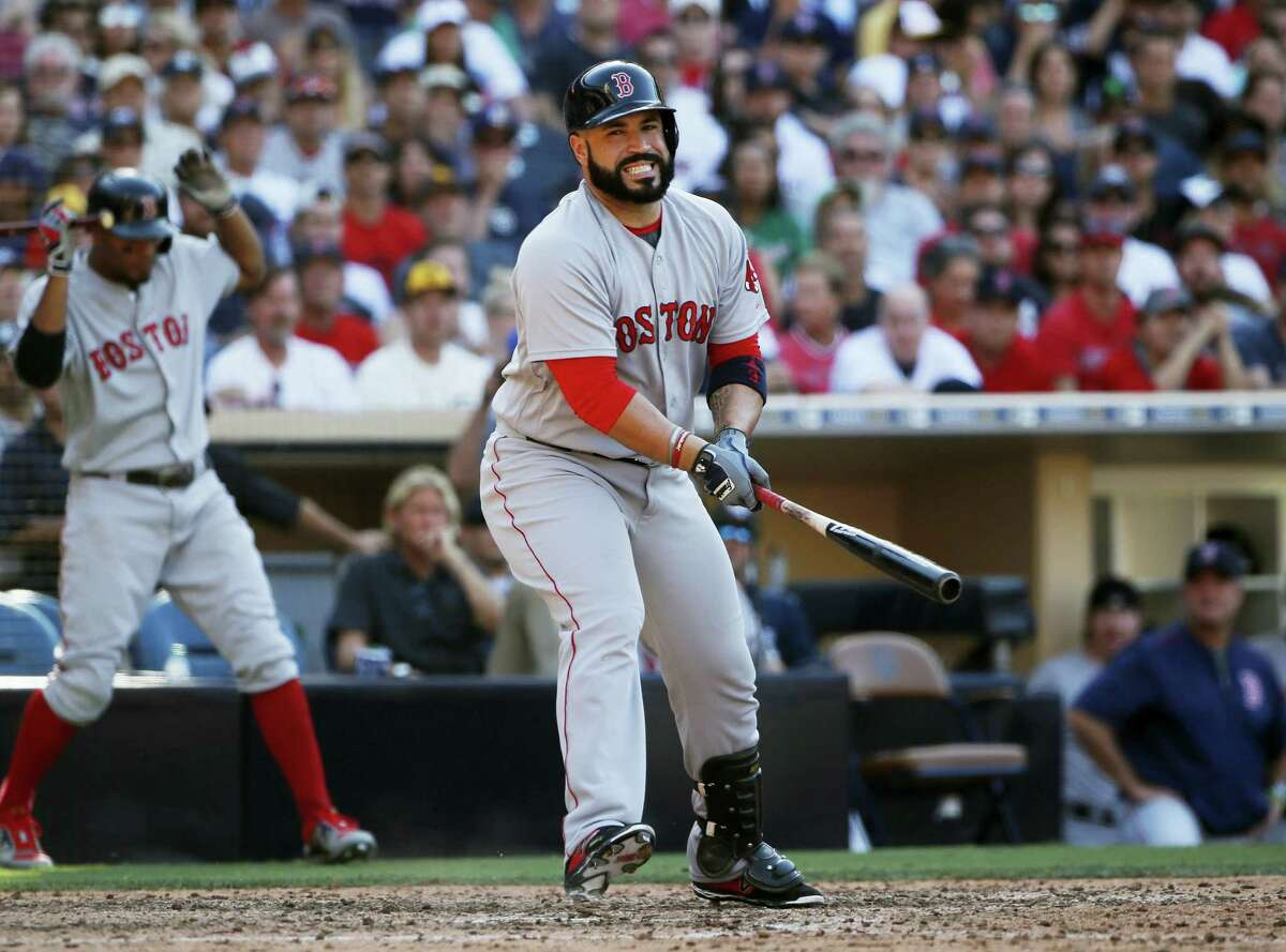 Boston's Sandy Leon reacts after swinging and missing while batting against the San Diego Padres with a runner on third during the eighth inning Monday. The Red Sox lost 2-1.