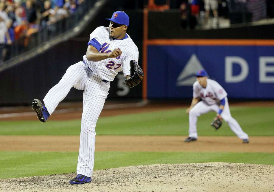 Mets reliever Jeurys Familia (27) follows through on a pitch during the ninth inning Saturday. Photo: Julie Jacobson — The Associated Press   / Copyright 2016 The Associated Press. All rights reserved. This material may not be published, broadcast, rewritten or redistribu