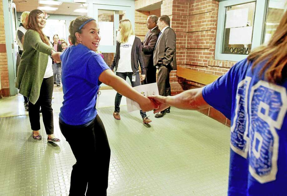 "Kyla Worroll, a Washington School special education teachers, holds hands in solidarity with other teachers and students during an Alliance to Reclaim Our Schools ""walk-ins"" rally at the Washington School Thursday morning, October 6, 2016 demonstrating success at the school.  The Alliance to Reclaim Our Schools is a coalition of 10 national advocacy groups dedicated to justice and equity in access to educational opportunities, according to a press release. Photo: Peter Hvizdak — New Haven Register   / ©2016 Peter Hvizdak"