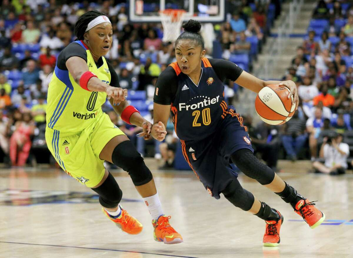 Dallas Wings' Odyssey Sims (0) defends as Connecticut Sun's Alex Bentley (20) moves to the basket in the second half of an WNBA basketball game, Saturday, July 2, 2016, in Arlington, Texas. (AP Photo/Tony Gutierrez)