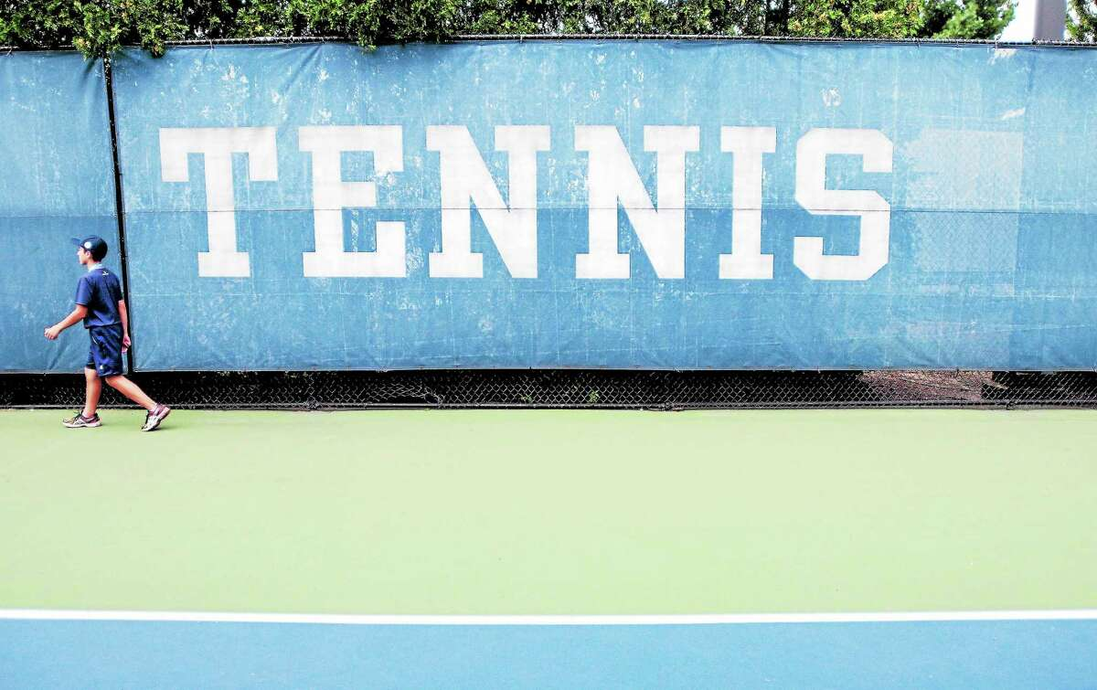 A ball boy walks past a court at the Connecticut Tennis Center during the New Haven Open at Yale in 2013.