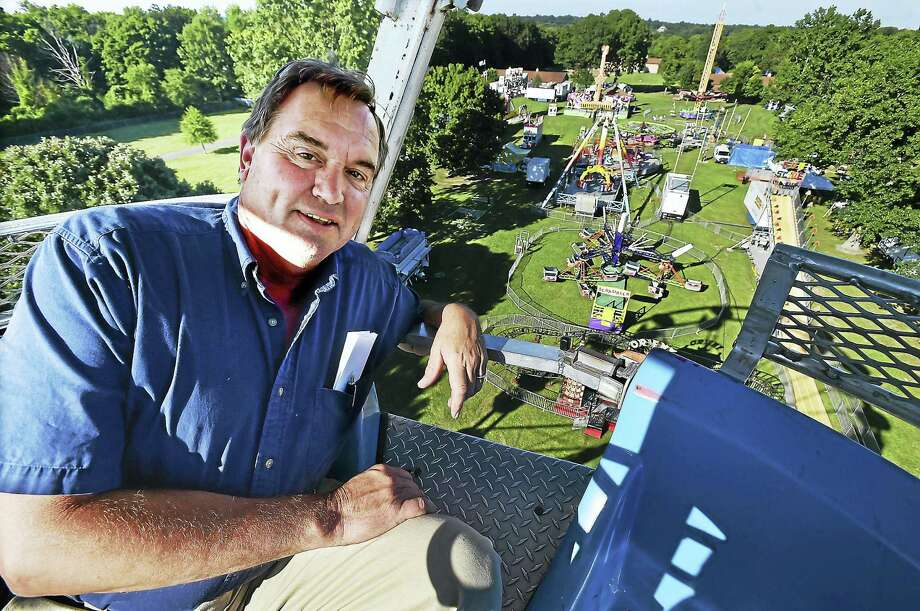Firefighter Don Foyer, aboard Rockwell Amusement's Ferris wheel, is in his eighth year as chairman of the annual Orange Volunteer Fire Association Carnival at the Orange Fairgrounds, 525 Orange Center Road. Photo: Catherine Avalone — New Haven Register    / New Haven RegisterThe Middletown Press