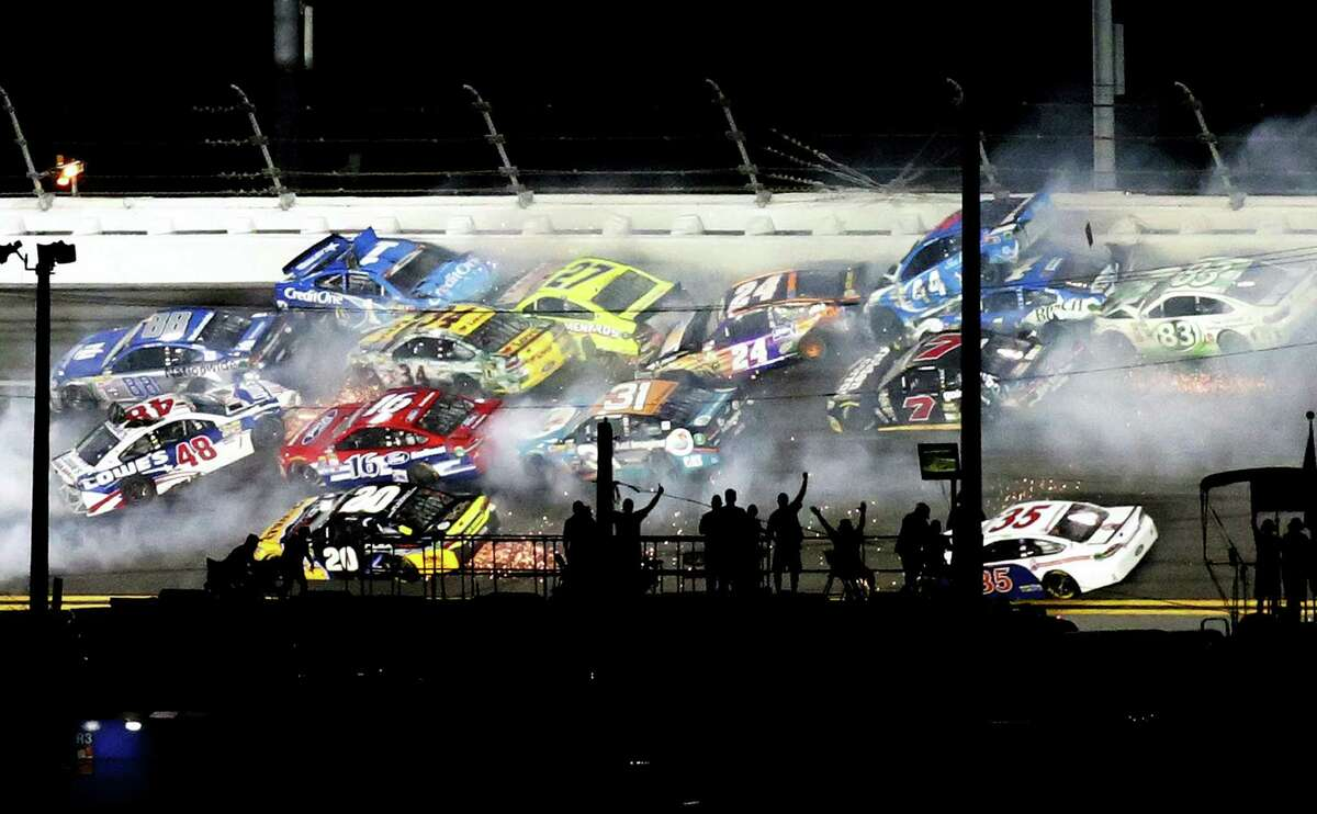 Several cars are involved in a crash on Turn 1 during Saturday's race at Daytona International Speedway.