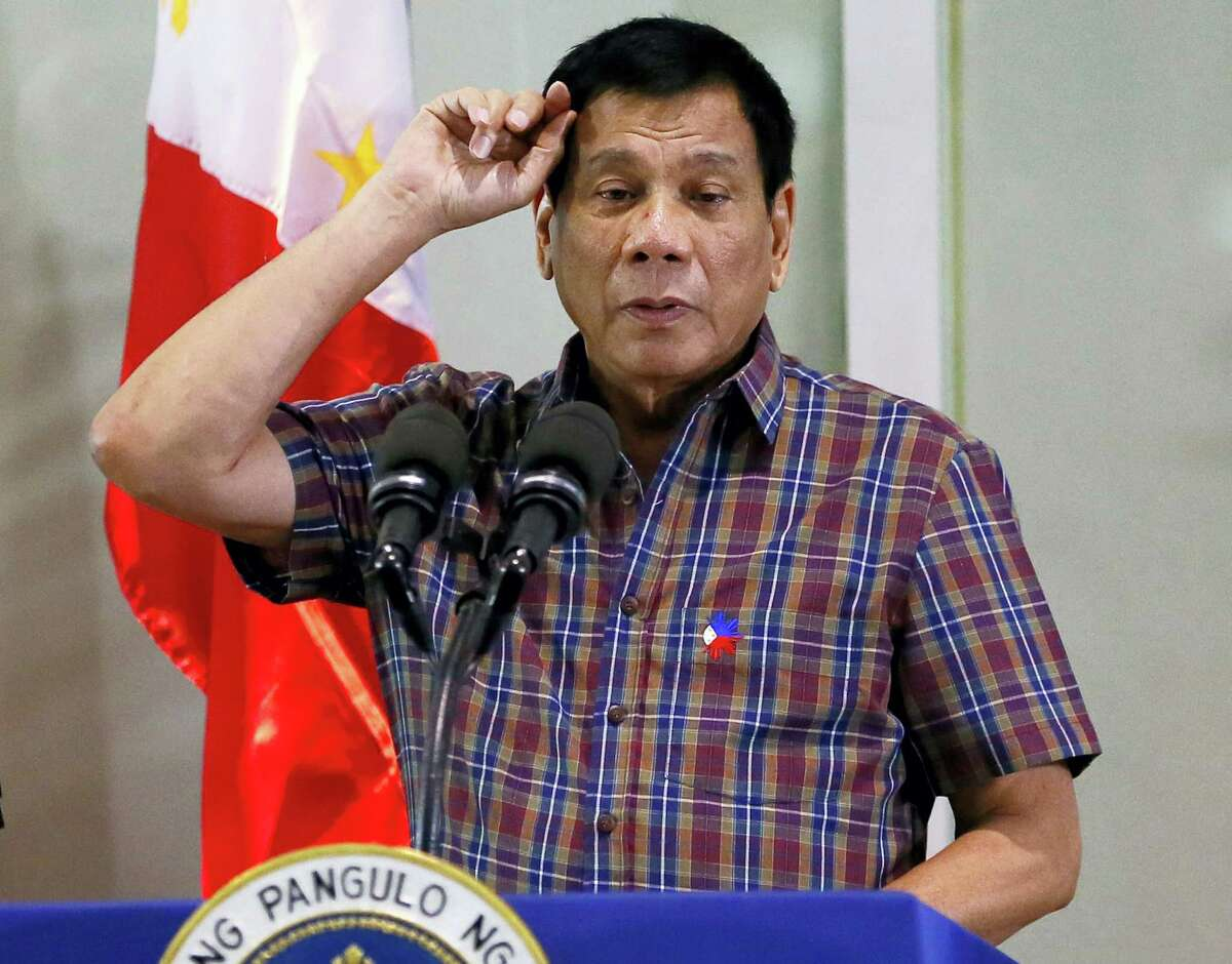 In this Aug. 31, 2016, file photo, Philippine President Rodrigo Duterte gestures as he addresses Overseas Filipino Workers who were repatriated back to the country at the Ninoy Aquino International Airport in Pasay city, south of Manila, Philippines. Duterte, who disparaged the pope and others who controvert his worldview, warns U.S. President Barack Obama on Monday, Sept. 5, 2016, not to question him about extrajudicial killings.