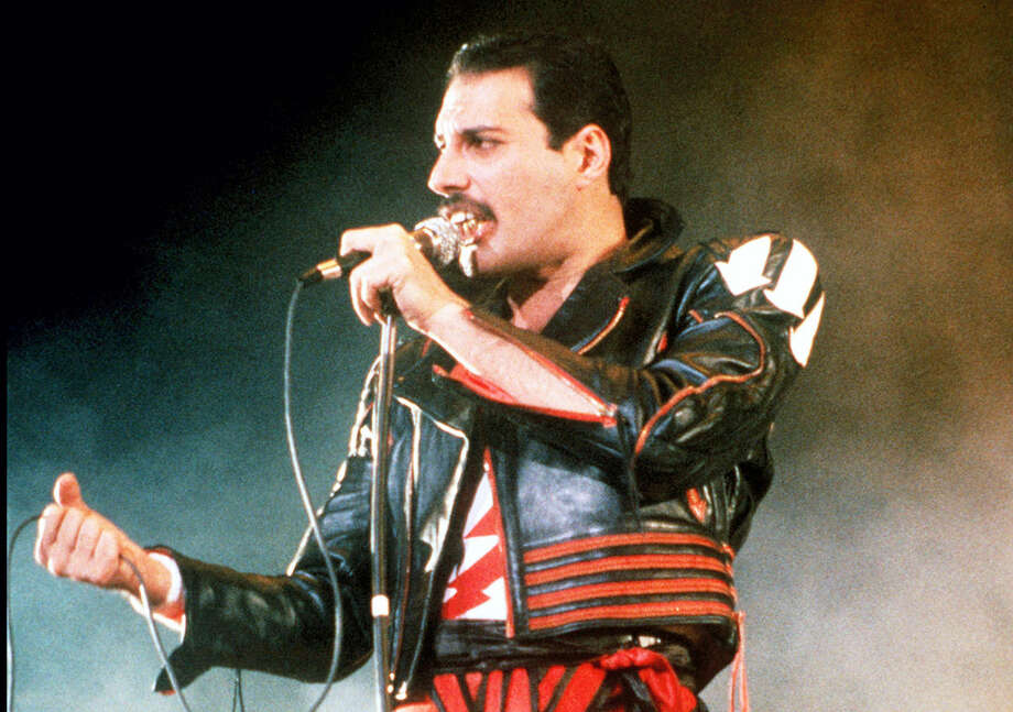 "In this 1985 file photo, singer Freddie Mercury of the rock group Queen, performs at a concert in Sydney, Australia. Queen guitarist Brian May says an asteroid in Jupiter's orbit has been named after the band's late frontman Freddie Mercury on what would have been his 70th birthday, it was reported on Monday, Sept. 5, 2016. May says the International Astronomical Union's Minor Planet Centre has designated an asteroid discovered in 1991, the year of Mercury's death, as ""Asteroid 17473 Freddiemercury."" Photo: AP Photo/Gill Allen, File    / AP2006"
