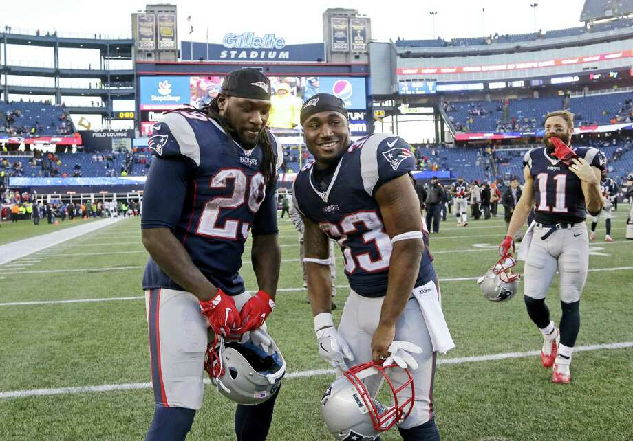 Patriots running backs LeGarrette Blount (29) and Dion Lewis (33) pose after last week's win over the Jets in Foxborough, Mass. Photo: Elise Amendola — The Associated Press   / Copyright 2016 The Associated Press. All rights reserved.