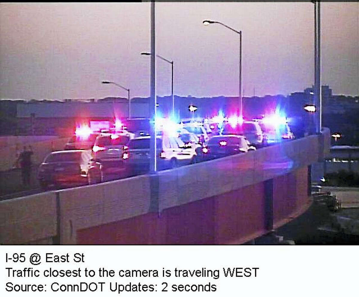 """This screenshot of the Connecticut Department of Transportation's traffic camera, """"CCTV# 78 New Haven NB Exit 48 - East St.,"""" shows the end of a police pursuit involving an alleged kidnapping."""