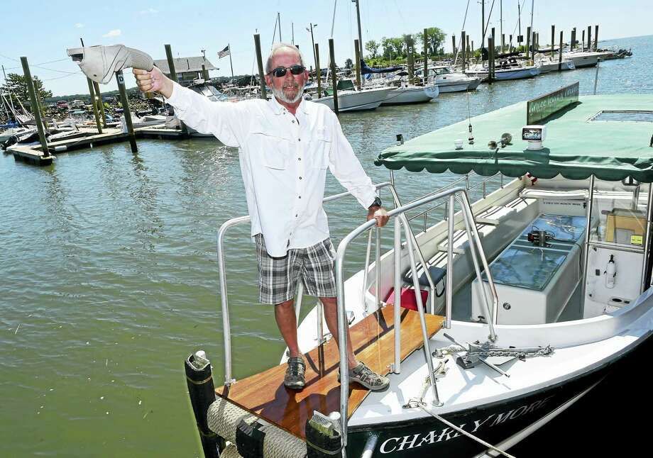 Captain Bill Bussmann of his 15 passenger Oldport Launch the Charly More, gives on-hour scenic shore and river cruises that depart from his home dock at the Lobster Landing on Whitfield Street in Guilford. Photo: Peter Hvizdak — New Haven Register   / ©2016 Peter Hvizdak