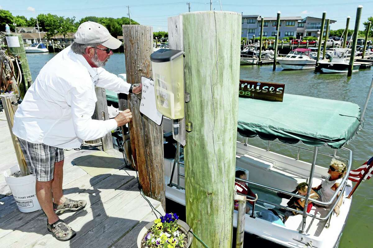 Captain Bill Bussmann logs in the amount of passengers he is taking on his 15 passenger Oldport Launch the Charly More. Bussman gives on-hour scenic shore and river cruises that depart from his home dock at the Lobster Landing on Whitfield Street in Guilford.