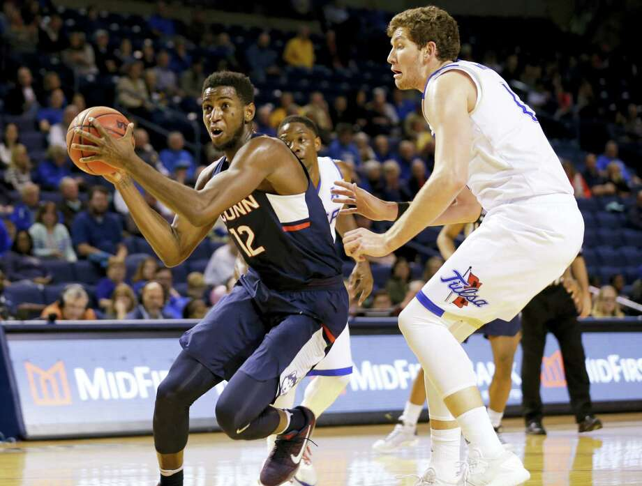 UConn's Kentan Facey, left, drives against Tulsa in the second half Saturday. Photo: Jessie Wardarski — Tulsa World Via AP   / Tulsa World