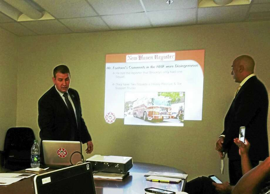 "New Haven Fire Union President Frank Ricci and Union Vice President Mark Vendetto presented their ""Save Your Neighborhood Fire Engine"" plan during a recent editorial board meeting at the New Haven Register as debate continues between city officials and the union over the city's plan Photo: Journal Register Co."