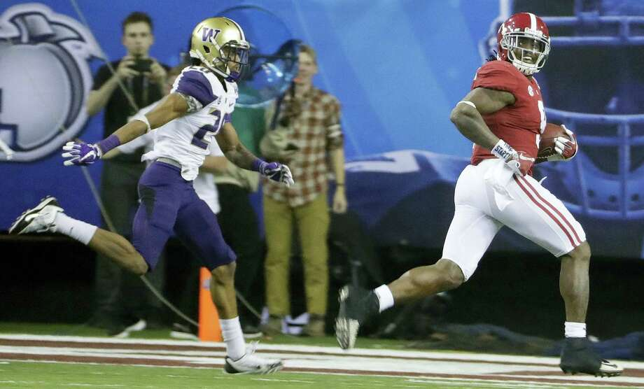 Alabama running back Bo Scarbrough (9) looks back as he runs for a touchdown against Washington during the second half of the Peach Bowl Saturday in Atlanta. Photo: David Goldman — The Associated Press   / Copyright 2016 The Associated Press. All rights reserved.