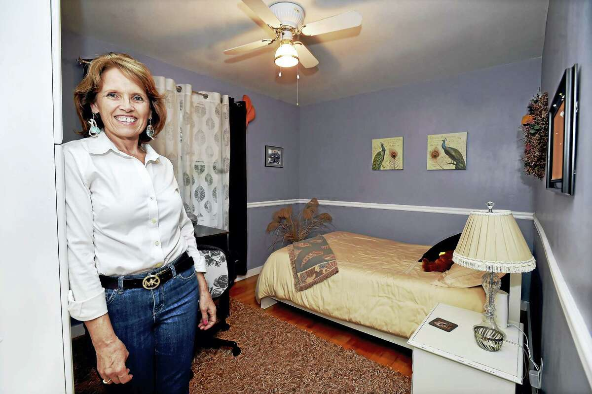 Massage therapist, Ann-Marie Mulholland who also operates an AirBnB is photographed Thursday, September 1, 2016, in one of the two bedrooms she rents out at her South Dale Street home in East Haven. East Haven's Planning & Zoning Department has approved Mulholland's AirBnB as a special exception under a rooming house regulation although the P&Z has not updated its zoning regulations to accommodate residents who would like to operate a Bed & Breakfast. Mulholland, an empty nester, has lived in her home for 32 years and especially enjoys hearing the stories from the travel nurses who have stayed at her home. (Catherine Avalone/New Haven Register)