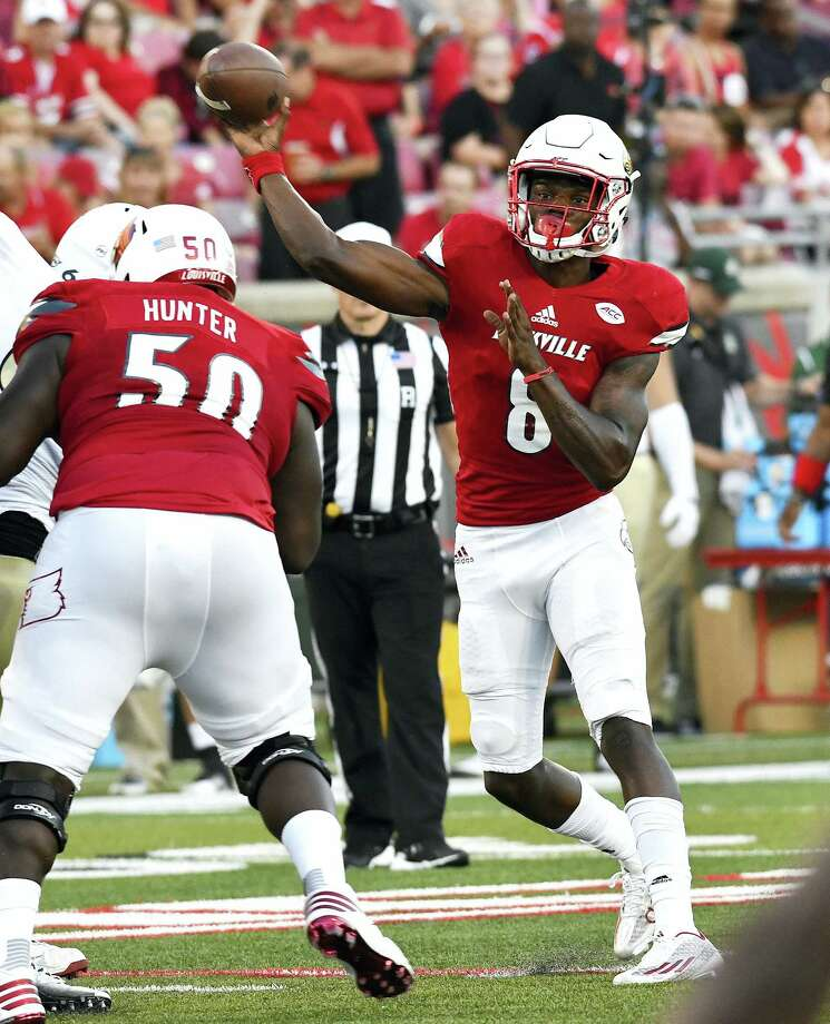 Louisville quarterback Lamar Jackson throws a pass during the first quarter on Thursday. Photo: The Associated Press    / FR43398 AP