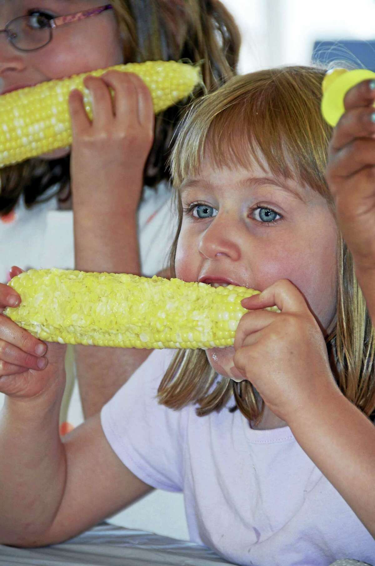 The joy of eating corn is on display at the festival.