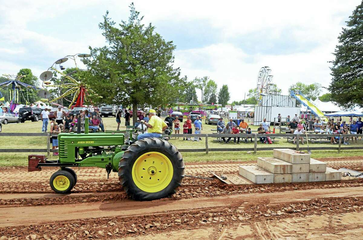 A tractor pull tests man and machine.