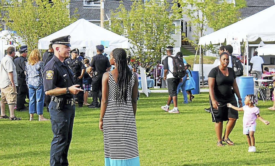 Residents and police were on hand Tuesday night for Hamden National Night Out. Photo: KATE RAMUNNI — NEW HAVEN REGISTER
