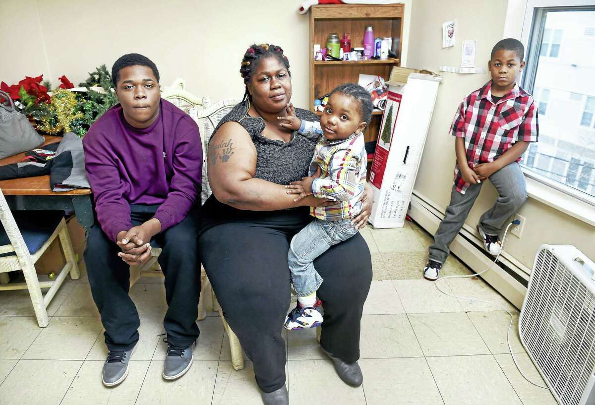 Latasha O'Bryan with three of her four children, from left, Kenneth Watts, 15, Jamyl Mercer, 2, and Isaiah Staton, 8, at her apartment in New Haven in January.