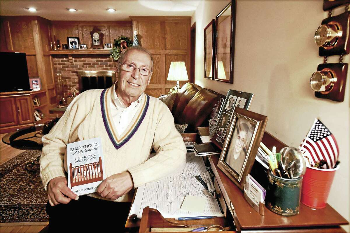 """Retired Superintendent of Schools Robert Nicoletti, author of """"Parenthood: A Life Sentence - A Journey from Womb to Tomb,"""" is photographed in his Wallingford home."""