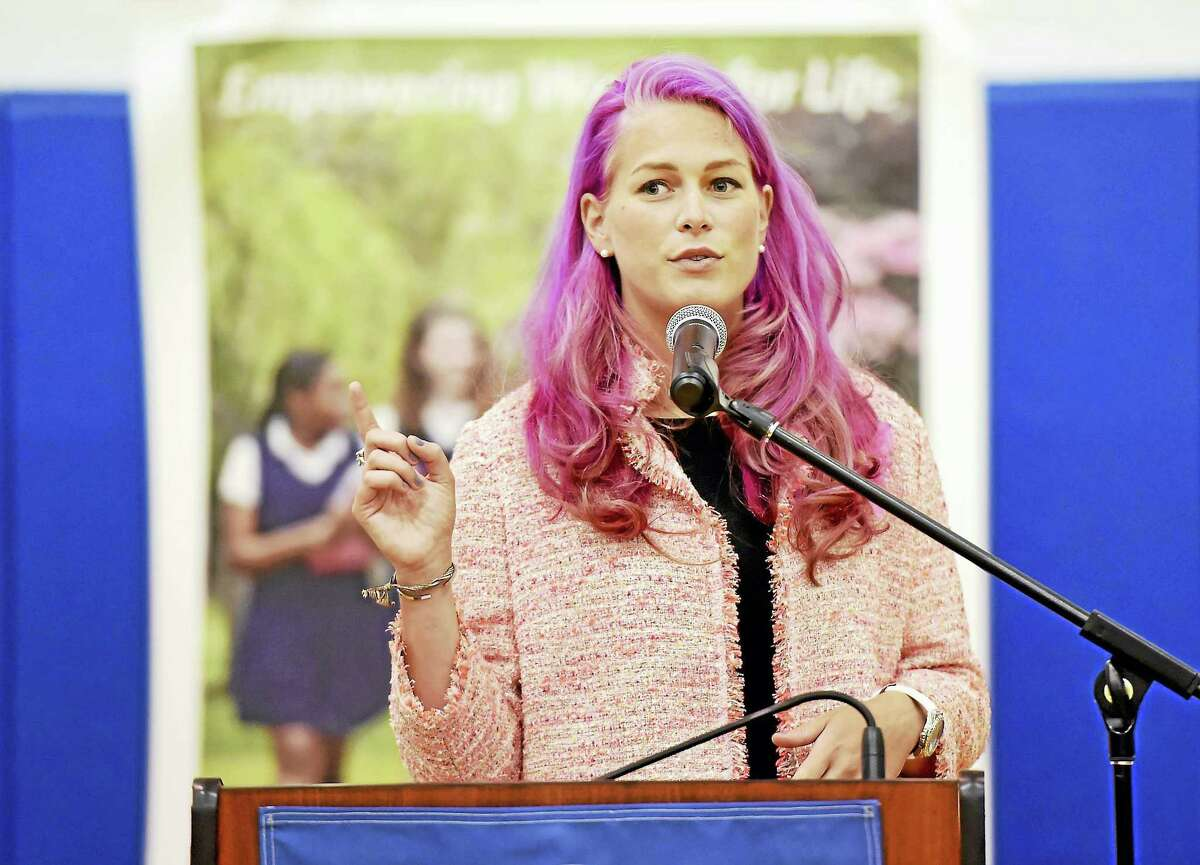 Betsy Nilan, president of the Get In Touch Foundation, speaks at Lauralton Hall in Milford Wednesday about a new state law that requires all public schools in to incorporate breast health education into their curriculum.