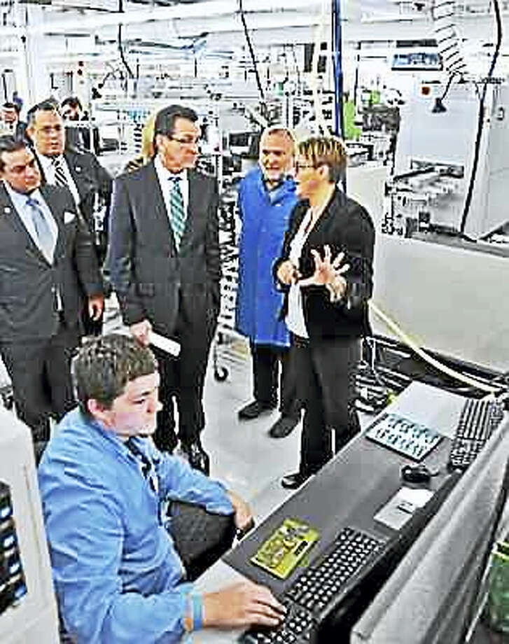 Gov. Dannel P. Malloy visits M.P.I. Corp. in Silvermine Industrial Park in Seymour in 2014. Photo: PETER CASOLINO — NEW HAVEN REGISTER FILE PHOTO