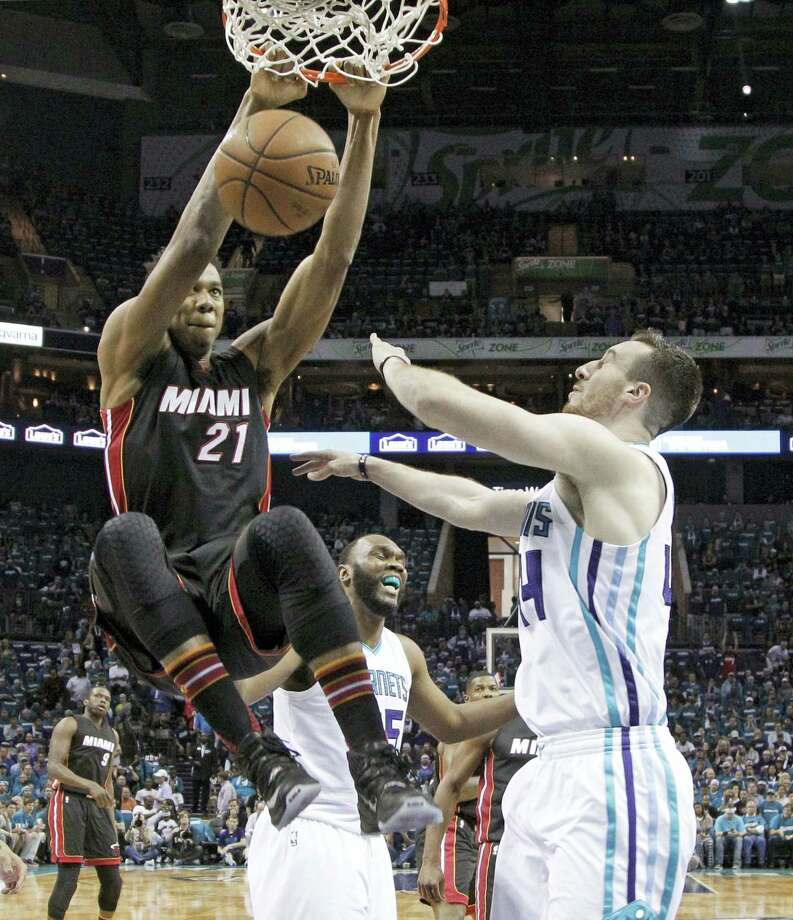 In this Monday, April 25, 2016 photo, Miami Heat's Hassan Whiteside (21) dunks over Charlotte Hornets' Frank Kaminsky (44) during the first half in Game 4 of an NBA basketball playoffs first-round series in Charlotte, N.C. Whiteside will be one of the most coveted targets when free agency begins FrIday, July 1, and there's no guarantee that the center whose career was resuscitated by the Miami Heat will be back with them next season. Photo: AP Photo/Chuck Burton, File   / Copyright 2016 The Associated Press. All rights reserved. This material may not be published, broadcast, rewritten or redistribu