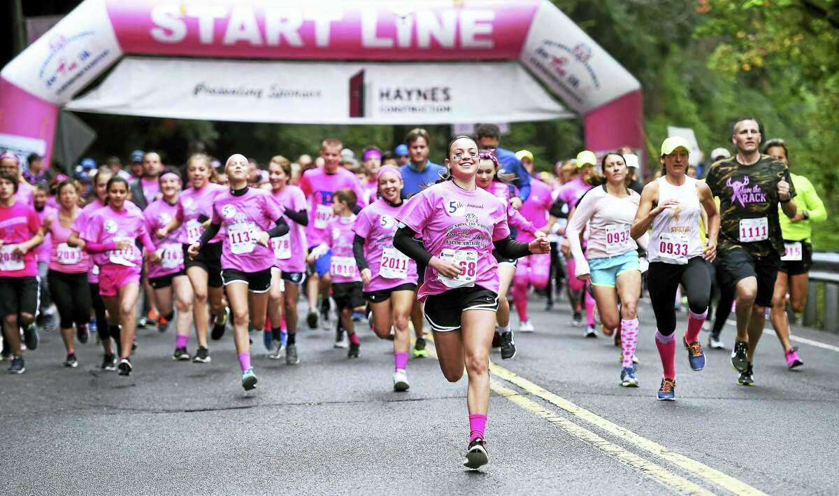 Arnold Gold — New Haven Register Runners begin the 5th Annual Pounding the Pavement for Pink 5K in Seymour Oct. 1.