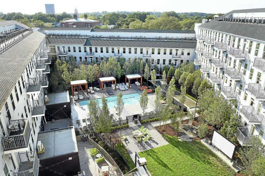 (Arnold Gold-New Haven Register)  Corsair Apartments in New Haven  photographed on 8/24/2016.  The courtyard includes outdoor sitting areas, a lap pool, bocci court, outdoor movie theater, ping pong and hammocks. Photo: Journal Register Co.