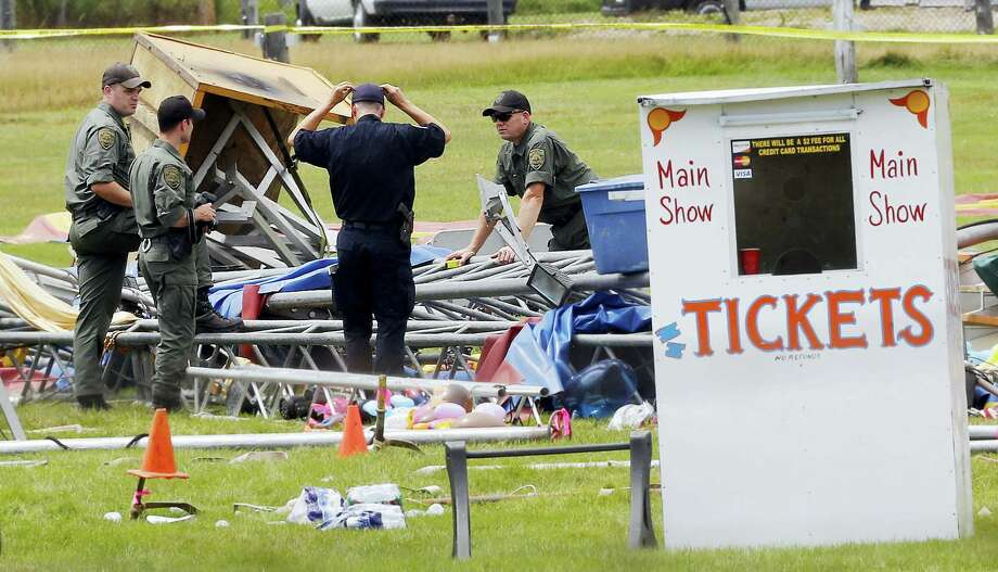 In a Aug. 4, 2015, file photo, investigators work at the scene of a circus tent that collapsed, killing a father and his 6-year-old daughter in Lancaster, N.H. A year after the circus tent collapsed, a Florida-based circus operator faces numerous charges and lawsuits. About 100 people were inside the tent on Aug. 3, 2015, at the Lancaster Fairgrounds when a storm blew through, toppling it. Photo: AP Photo/Jim Cole, File    / Copyright 2016 The Associated Press. All rights reserved. This material may not be published, broadcast, rewritten or redistribu