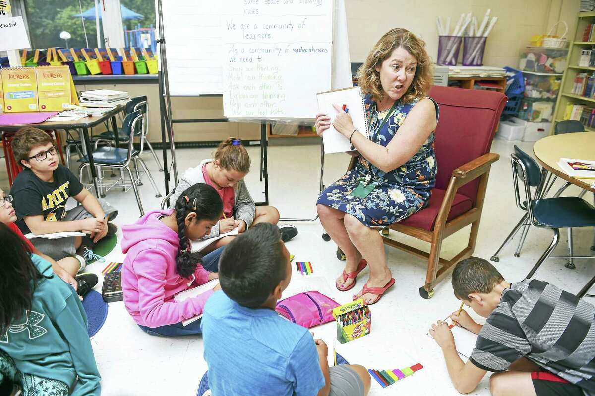 (Arnold Gold-New Haven Register) Nicole Gilson teaches math to her fifth grade students at Peck Place School in Orange on 9/1/2016. She is traveling to the White House in Washington, D.C., to be honored with a Presidential Award for Excellence in Mathematics and Science Teaching.
